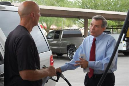 David pumps gas and talks with constituents in Scottsdale